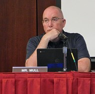 Van Wert City Board of Education member Scott Mull listens to a presentation during Wednesday's meeting.